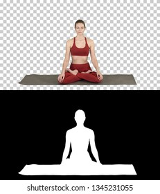 Sporty attractive woman practicing yoga, sitting in Lotus exercise, Siddhasana pose breathing, Alpha Channel