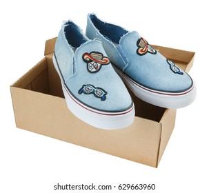 Sporty blue sneakers in a beige cardboard box on white