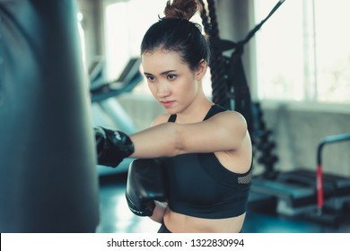 Sporty Boxer is Exercise Punching in Fitness Gym.,Portrait of Boxing Woman is Practicing Footwork in Sportswear and Boxing Gloves., Handsome Man is Doing Exercise Punching With Training Bag.