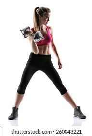 Sporty brunette girl with dumbbell / photo set of sporty muscular female brunette girl wearing sports clothes working out with dumbbell over white background