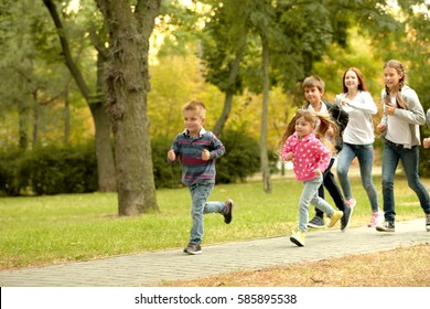 Sporty children running in the park
