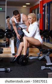 Sporty couple exercising at the gym