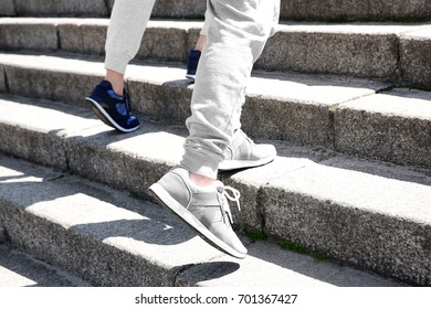 Sporty couple running up stone stairs