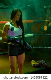 sporty female boxer in ring after fight