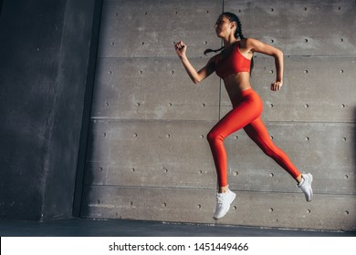 Sporty fit woman runner athlete side view Fitness loss weight cardio training jworkout.