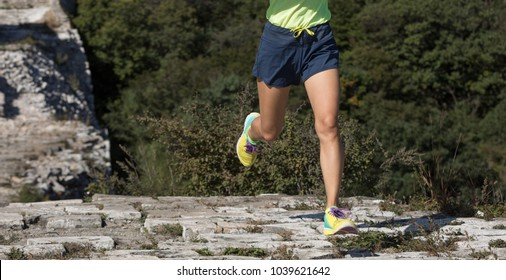 sporty fitness woman runner running on the top of great wall