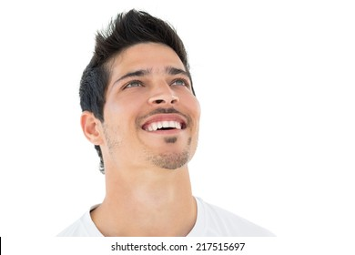 Sporty football fan looking up over white background