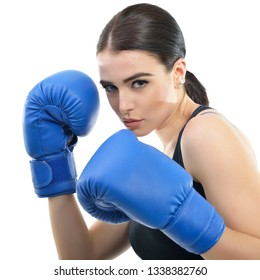 Sporty girl doing boxing exercises. Photo of young woman with boxing gloves  isolated on white background. Strength, motivation, health and beauty.