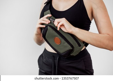 Sporty girl with fanny bag on white background