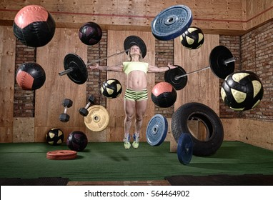 sporty girl levitates in a gym environment,a rowing machine,balls,dumbbells,stationary bike
