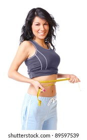 Sporty girl measuring her weist with tape, weight loss
