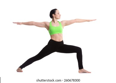 Sporty girl on white background doing lunge exercise, Warrior II posture, Virabhadrasana 2