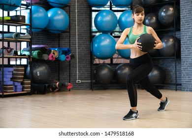 sporty girls doing exercises with fitness balls in the gym.