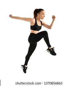 Sporty jumping woman on white background