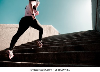 Sporty lady having stair speed workout on the street stock photo