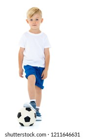 A sporty little boy is playing with a soccer ball. Concept of a healthy lifestyle, sport and fitness. Isolated on white background.