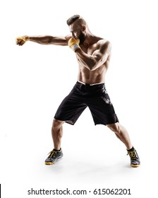 Sporty man during boxing exercise making direct hit. Photo of boxer on white background. Strength and motivation