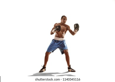 Sporty man during boxing exercises. Photo of boxer on isolated on white background. Strength, attack and motion concept. Fit african american model in movement. Afro muscular athlete in sport uniform