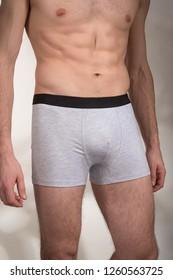 Sporty man in gray panties