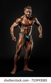 Sporty man on black background
