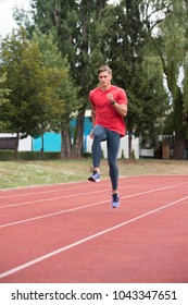 Sporty Man Running Fitness Workout on Track Exercising Outside
