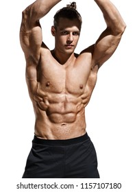 Sporty man showing off his muscular physique and six pack abs. Photo of young man with perfect body after training on white background. Strength and motivation
