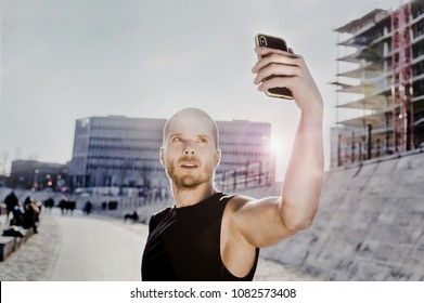 Sporty man taking a selfie in the city