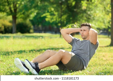 Sporty man training in park