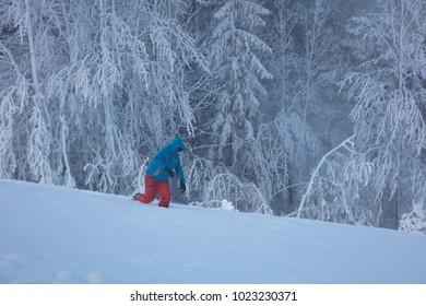 Sporty man walking in the snow.