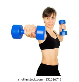 Sporty middle aged woman and dumbbells / active sport life