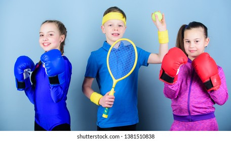 Sporty siblings. Ways to help kids find sport they enjoy. Friends ready for sport training. Child might excel completely different sport. Girls kids with boxing sport equipment and boy tennis player.