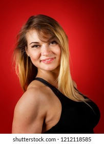 sporty smiling muscular girl with white hair on red background, close-up portrait