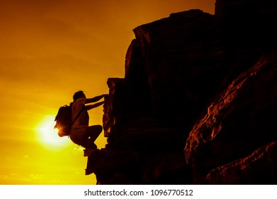 Sporty woman climbing on the cliff. Personal transformation for business successful concept. Business development and improvement. Strong and healthy for outdoor activity.