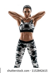 Sporty woman doing exercises with kettlebell. Photo of latin woman in military sportswear isolated on white background. Strength and motivation