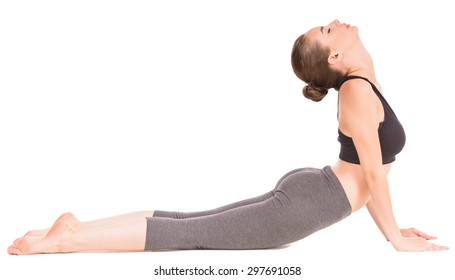 Sporty woman doing yoga exercise  in cat pose.