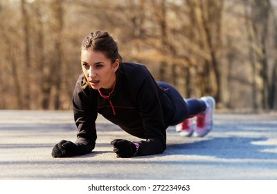 Sporty woman exercising in the morning outdoor.