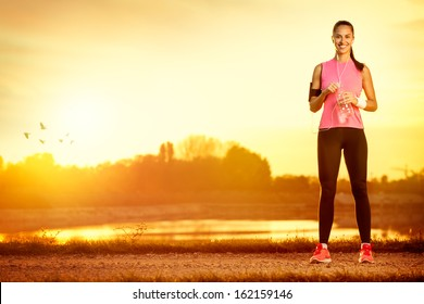 sporty woman exercising outdoor on sunny day