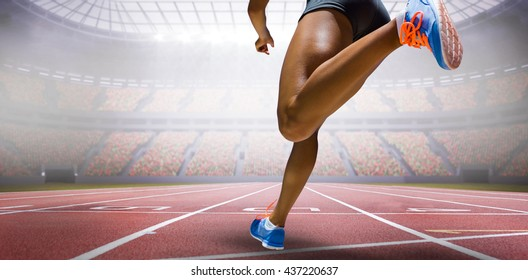 Sporty woman finishing her run against view of a stadium