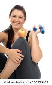 sporty woman with hantels and apple / healthy living