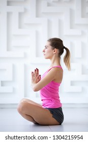 Sporty woman in the lotus position. Home Yoga.