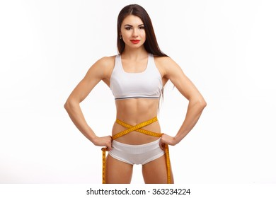 Sporty woman and measure around her body on white background