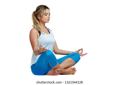 Sporty woman meditating against white background
