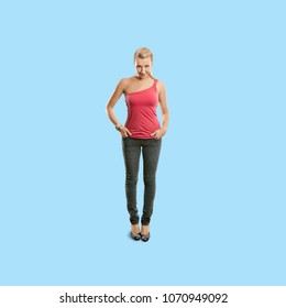 Sporty woman in pink standing and looking on camera, isolated on trendy gradient background. Full length