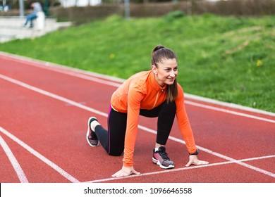 Sporty Woman Runner Preparing For Running