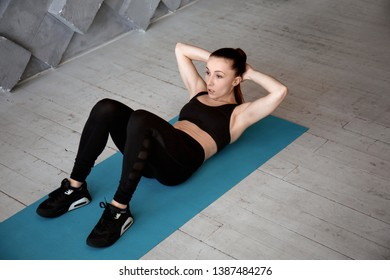 Sporty woman training in gym