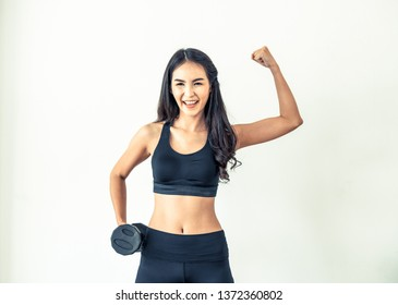 Sporty woman workout with dumbbell on clear background. Healthy lifestyle and exercising.