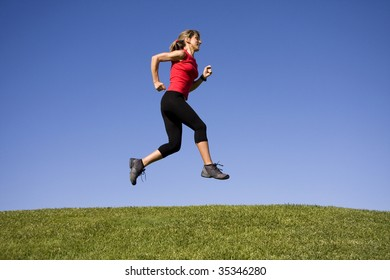 Sporty women running on the park