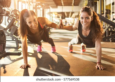 Sporty women working out together at gym.