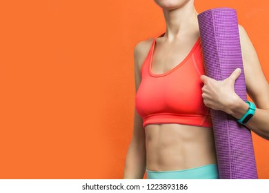 Sporty yoga girl with yoga mat over bright background