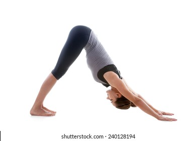 Sporty yoga girl on white background stretching in pose Adho Mukha Svanasana (downward-facing dog Pose, downward dog, down dog)